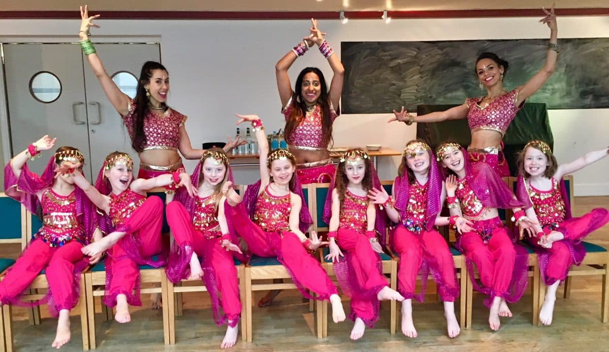 A group of girls and dancer during a Bollywood style dance party