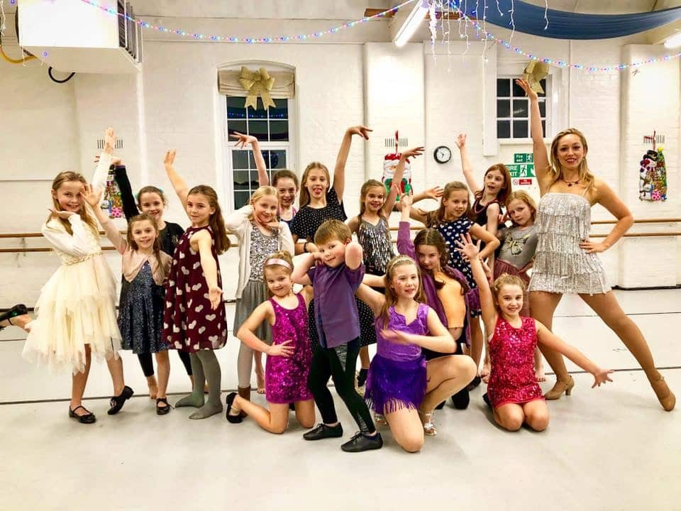 Group of children posing after a Strictly themed party