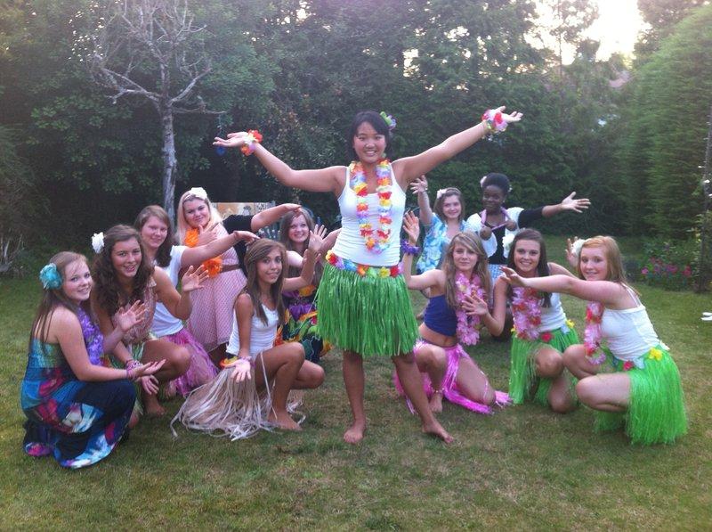 Teenagers in Hawaiian costumes