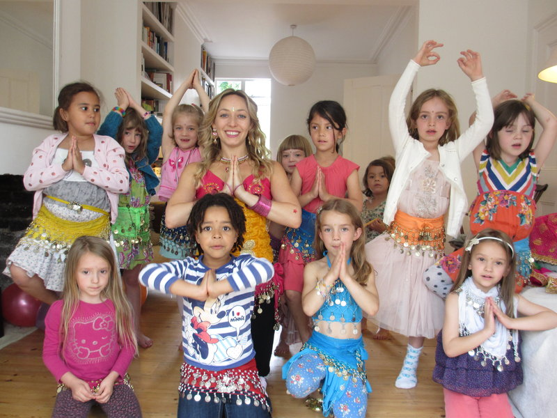 Girls holding hands in preyer position at an Indian dance party