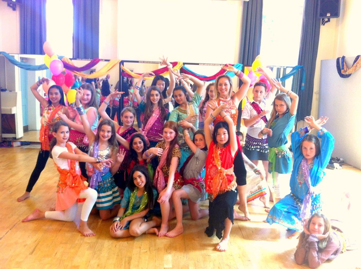 Girls posing in Bollywood costumes