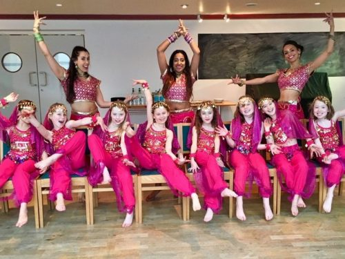 Group of girls and teachers all wearing pink Bollywood costmes