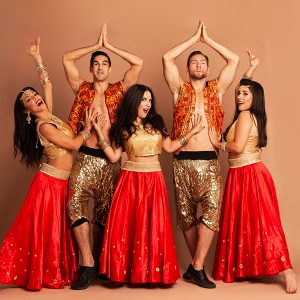 Male and female dancers posing in red and gold