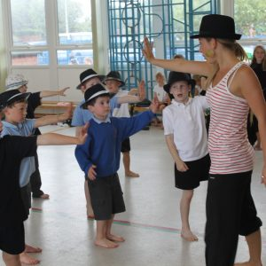 Boys dancing wearing Trilby hats