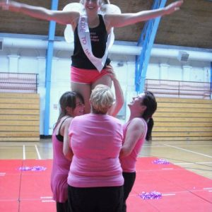 Women in wings being lifted into the air