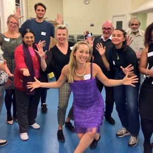 Group of adults with jazz hands