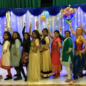 Group of women posing in Indian outfits