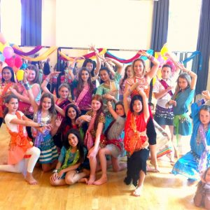 Girls posing in Bollywood costumes