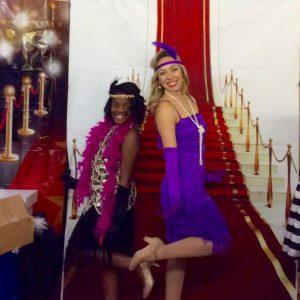 Girl and dance teacher posing on a red carpet