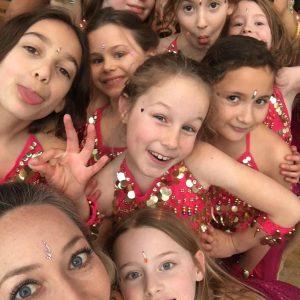 Lots of girls posing for a selfie