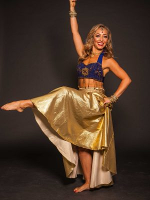 Blonde dancer posing in a Bollywood costume